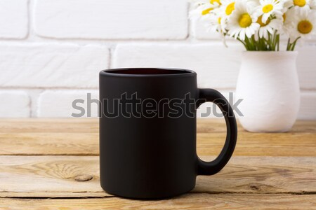 Schwarzer Kaffee mug Kamille Bouquet rustikal Stock foto © TasiPas