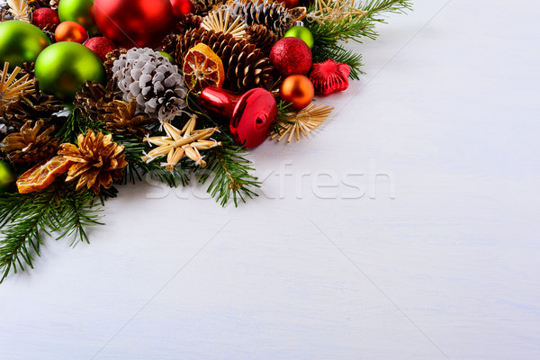 Red and green Christmas ornaments, fir branches and pine cones Stock photo © TasiPas