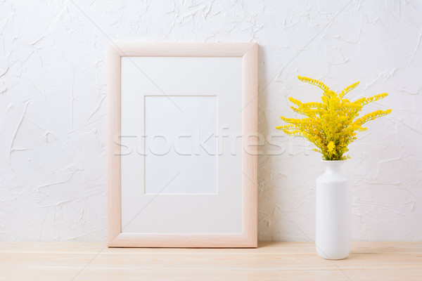 Wooden frame mockup with ornamental yellow flowering grass in va Stock photo © TasiPas