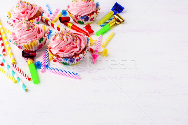Birthday party background with pink buttercream frosting cupcake Stock photo © TasiPas
