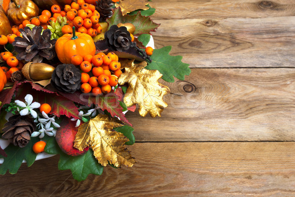 Thanksgiving garland with squash and berries copy space Stock photo © TasiPas