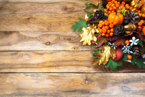 Fall greeting with berries and cones wreath, copy space Stock photo © TasiPas