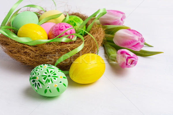 Easter table centerpiece with yellow and green painted eggs in t Stock photo © TasiPas
