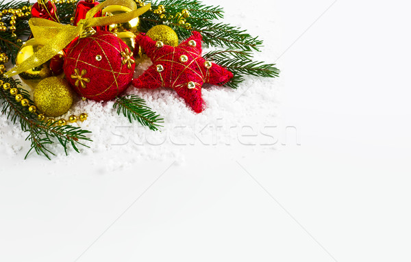 Christmas background  with golden beads and fir branches Stock photo © TasiPas