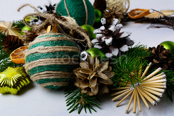 Christmas decoration with snowy pine cones and rustic bauble Stock photo © TasiPas