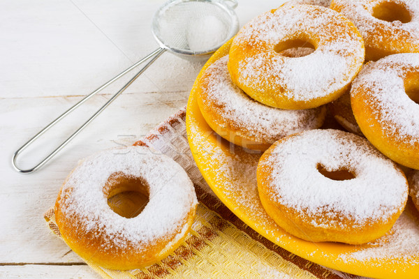 Homemade donuts powdered by caster sugar  Stock photo © TasiPas
