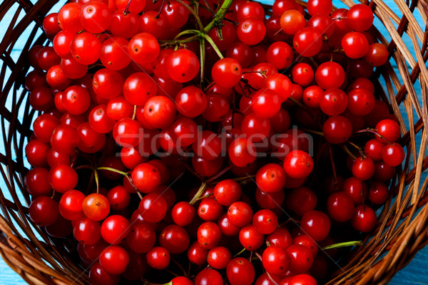 Forest berries in wicker basket top view Stock photo © TasiPas