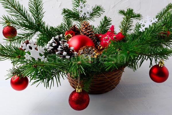 Karácsony piros dísz díszített fonott kosár Stock fotó © TasiPas