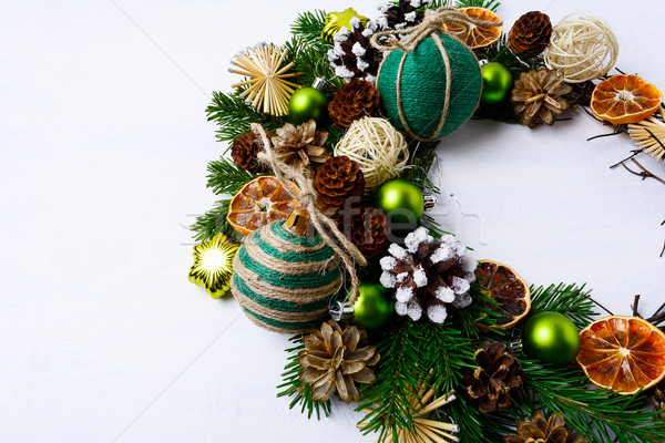 Christmas wreath with rustic handmade straw stars and pine cones Stock photo © TasiPas