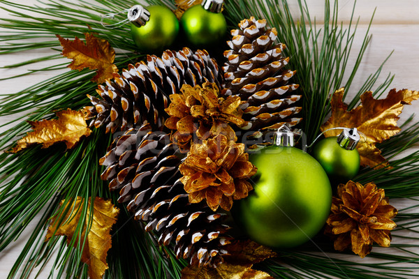 Christmas golden pine cones decorated wreath Stock photo © TasiPas