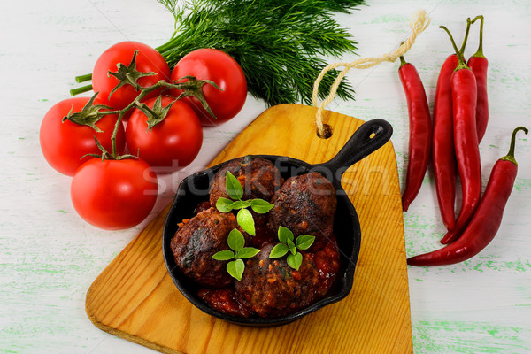 Grilled beef meatballs with chili pepper  served in skillet Stock photo © TasiPas