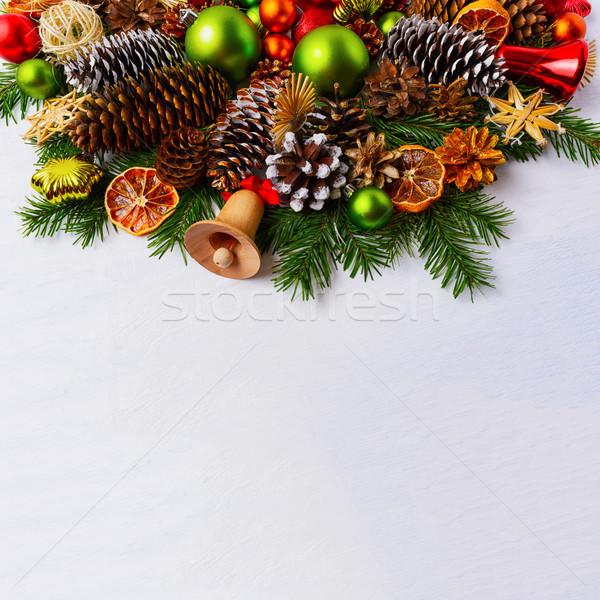 Karácsony egyezség fenyő ágak zöld golyók Stock fotó © TasiPas