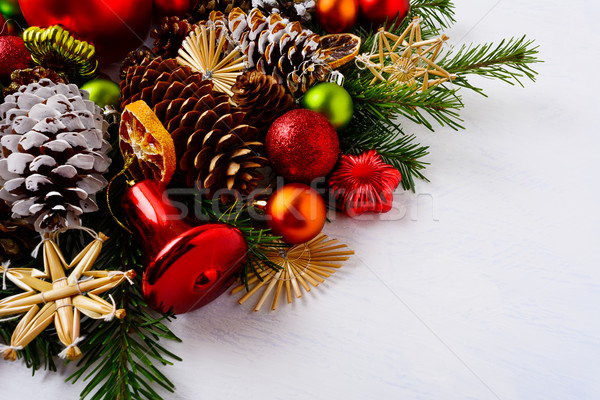 Christmas decoration with dried orange slices, red jingle bell a Stock photo © TasiPas