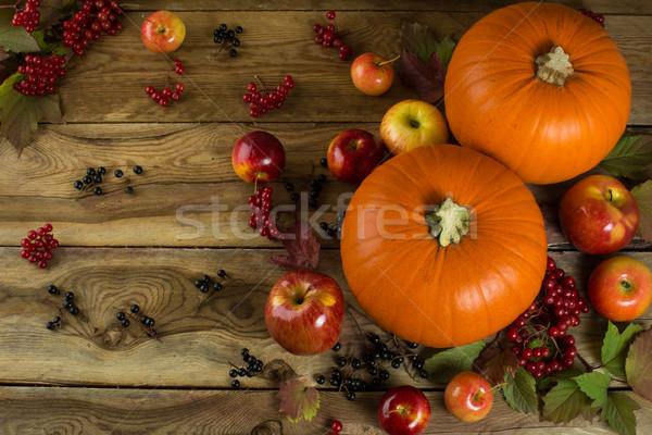 Pumpkins on wooden table Stock photo © TasiPas