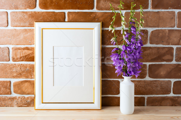 Gold decorated frame mockup with bellflower bouquet exposed bric Stock photo © TasiPas