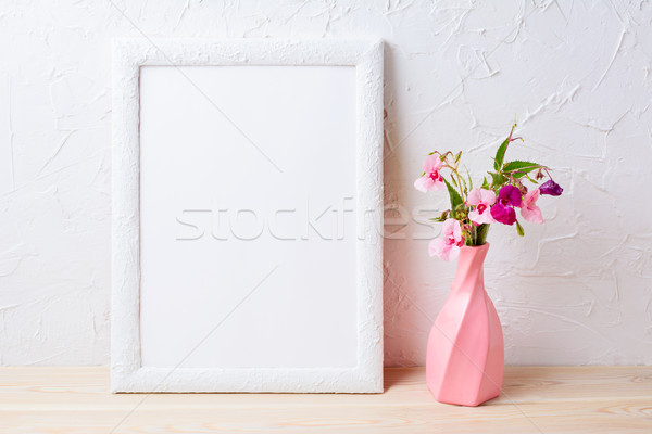 White frame mockup with flowers in swirled pink vase Stock photo © TasiPas