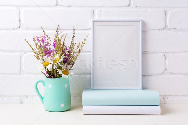 Stock photo: White frame mockup with chamomile and purple flowers in mint gre