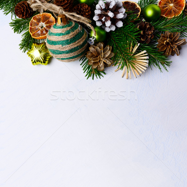 Christmas background with rustic ornaments and dried orange slic Stock photo © TasiPas