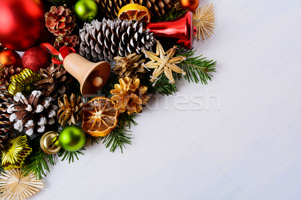 Christmas greeting card with fir branches and wooden jingle bell Stock photo © TasiPas
