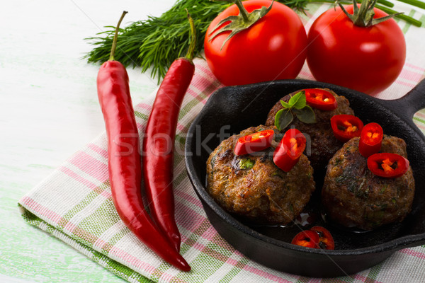 Grilled meatballs with chili pepper Stock photo © TasiPas