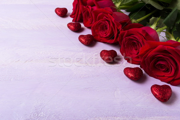 St. Valentine greeting background with five dark red rose  Stock photo © TasiPas