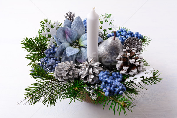 Christmas table centerpiece with candle and blue silk poinsettia Stock photo © TasiPas