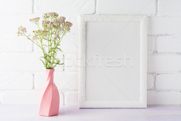 White frame mockup with creamy pink flowers in swirled vase Stock photo © TasiPas