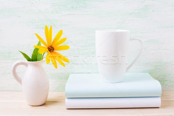 White cappuccino mug mockup with yellow rosinweed flowers in pit Stock photo © TasiPas