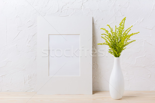 White mat frame mockup with ornamental grass in exquisite vase Stock photo © TasiPas