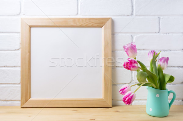 Wooden square frame mockup with pink tulip in mint pitcher vase Stock photo © TasiPas