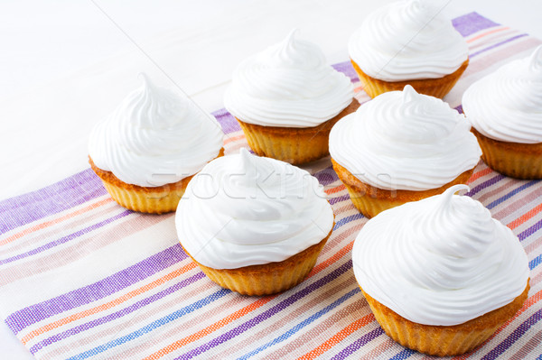 Birthday cupcakes with white whipped cream swirl Stock photo © TasiPas