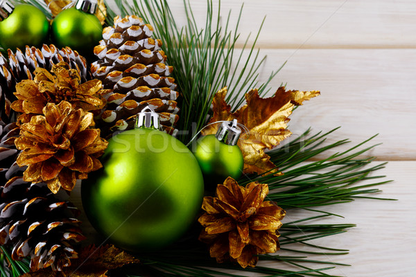 Stock photo: Christmas green ornaments and golden decorated pine cones