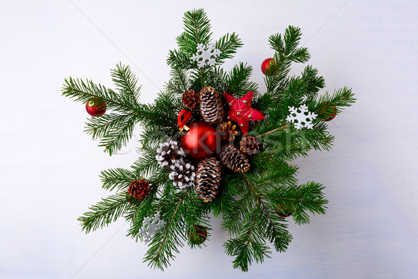 Christmas red ornaments and snowy decorated pinecone wreath Stock photo © TasiPas