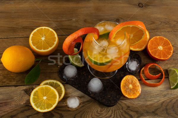 Iced tropical fruit cocktail on wooden table Stock photo © TasiPas