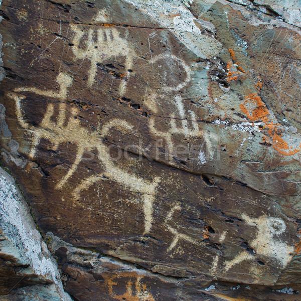 Hunting scenes palaeolithic Petroglyphs Stock photo © TasiPas