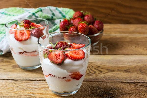 Summer dessert with whipped cream and strawberry on wooden backg Stock photo © TasiPas