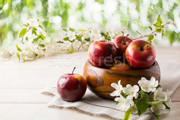 Ripe apples in wooden bowl Stock photo © TasiPas