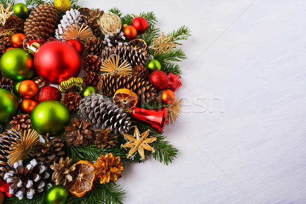 Christmas arrangement with red, green ornaments, straw stars, co Stock photo © TasiPas