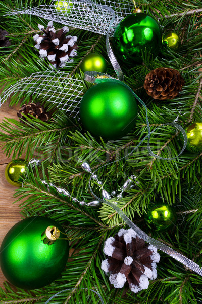 Christmas green baubles, pine cones and silver beads swag Stock photo © TasiPas