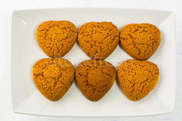 Heart shaped oatmeal cookies on white plate Stock photo © TasiPas