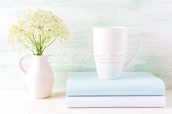 White cappuccino mug mockup with wild meadow flowers in pitcher Stock photo © TasiPas