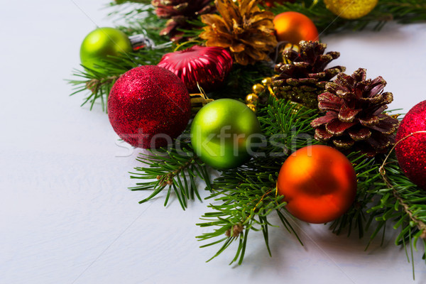 Natale rosso arancione verde ornamenti ghirlanda Foto d'archivio © TasiPas