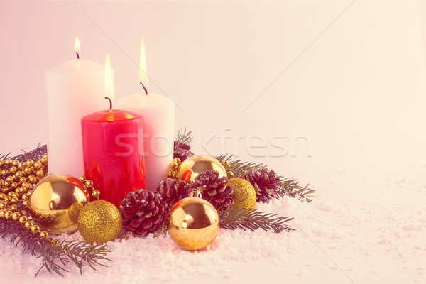Christmas red and white candles arrangement, vintage toned Stock photo © TasiPas
