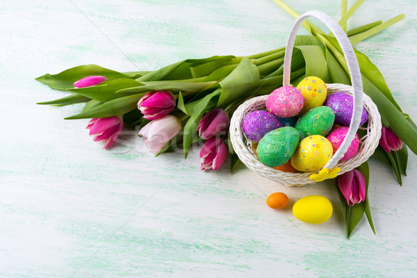 Easter star decorated glitter eggs in yellow wicker basket backg Stock photo © TasiPas