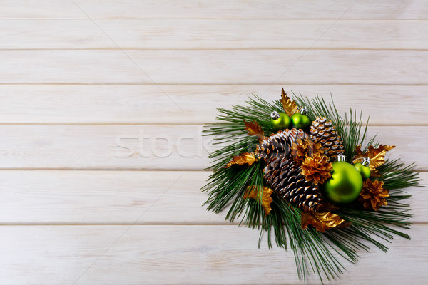 Christmas greeting with pine branches and golden cones Stock photo © TasiPas