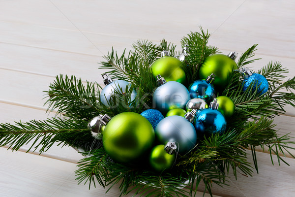 Christmas table centerpiece with silver, blue and green ornament Stock photo © TasiPas