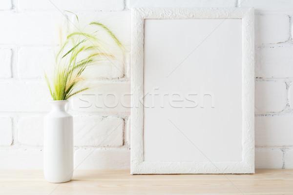 White frame mockup with wild grass ears near painted brick wall Stock photo © TasiPas