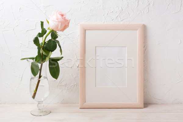 Wooden frame mockup with rose in exquisite glass vase Stock photo © TasiPas