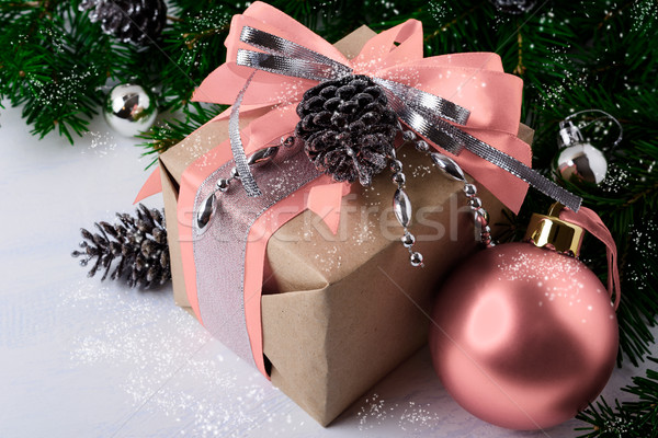 Christmas decorated gift box with pink ribbon  Stock photo © TasiPas