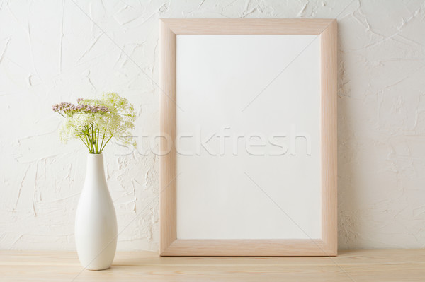 Frame mockup with tender flowers in white stylish vase  Stock photo © TasiPas
